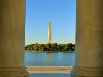 The Washington Monument framed between the pillars of the Jefferson Memorial