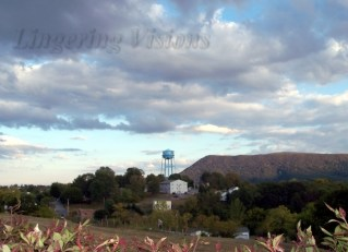This is one of my favorite shots. You can see the water tower and signal knob but also an older man in his garden.