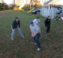 """""""The boys"""" playing football at Thanksgiving."""