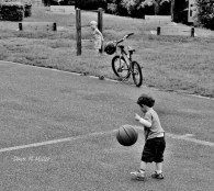 I laughed at this little guy trying to handle a basketball as big as him.