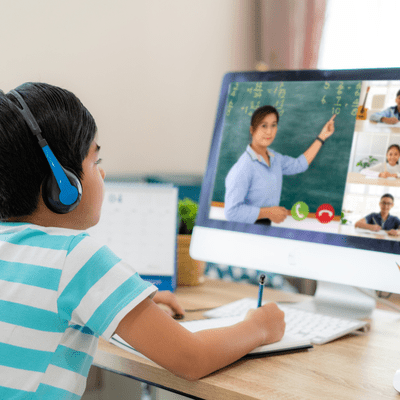 Image of child at a computer learning.