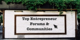 Top online entrepreneur forums - image of small business owners looking at a motivational sign that says