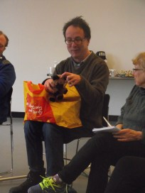 Participant telling his story using a brown teddy bear