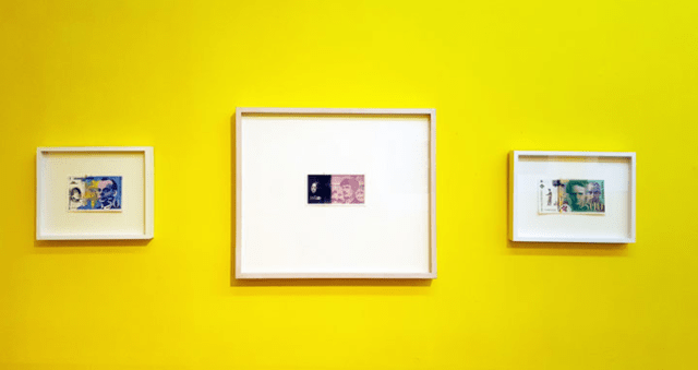 Installation view featuring Peggy Preheim's three works on paper from her French franc note series created in 2001, a year before the Euro currency was introduced.