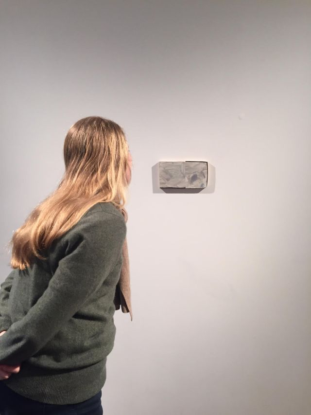 artist's friend looking at Moon Room, 2016, oil on panel, 5 x 9 inches