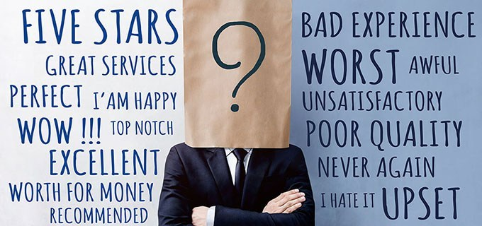 Customer Experience Concept, Happy Businessman Client with Question Mark Icon on Paper Bag, Crossed arms and wearing Suit. Concrete Wall with Wording of Positive and Negative Reviews