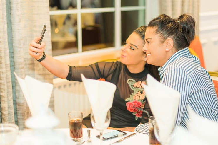 candid portrait of girls taking a selfie