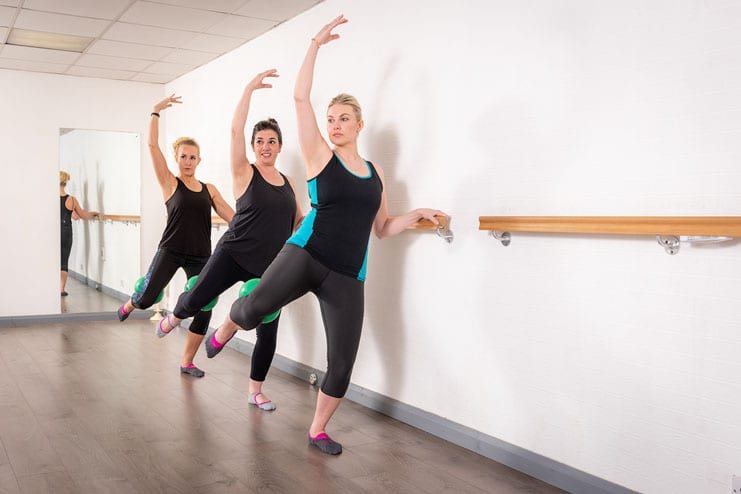 3 pilates students pose for environmental portraits