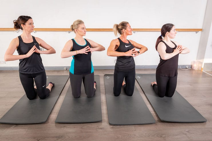 pilates students pose for environmental portraits