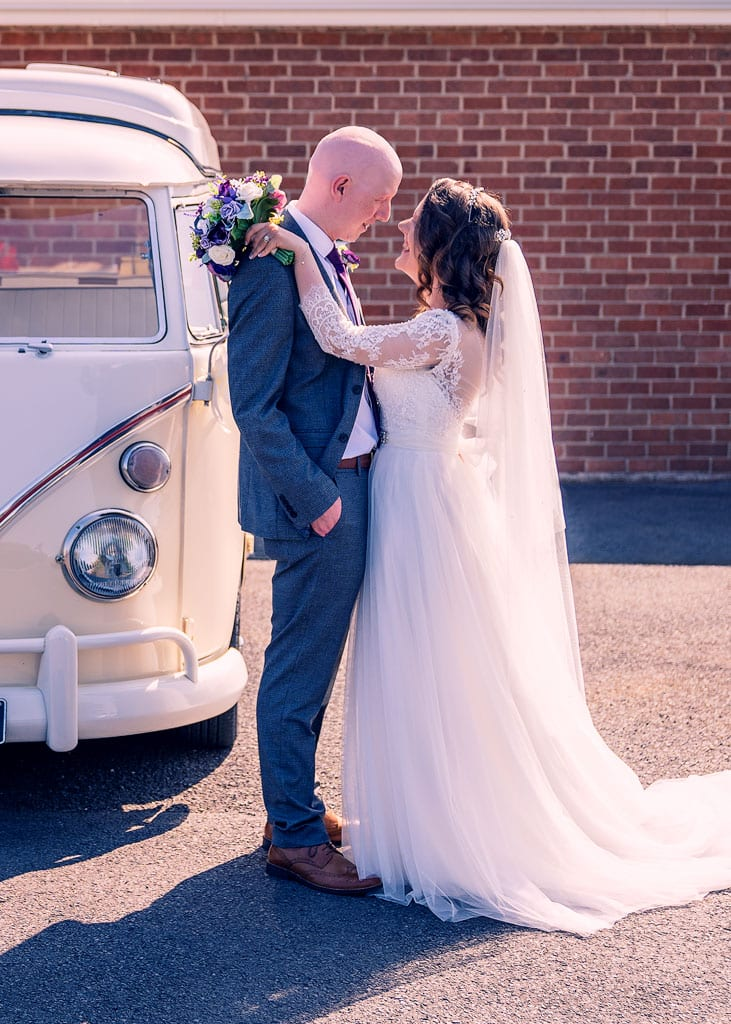 bride and groom portrait by vw camper van wedding car