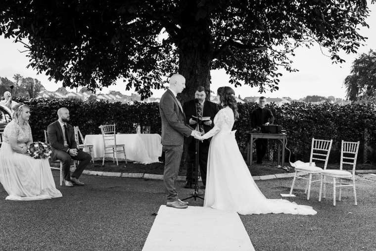 outdoor socially distant wedding ceremony under oak tree