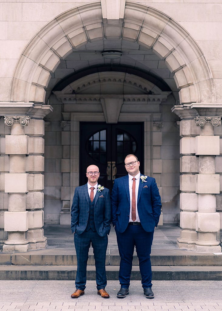 Groom and Best Man Portrait in Arch