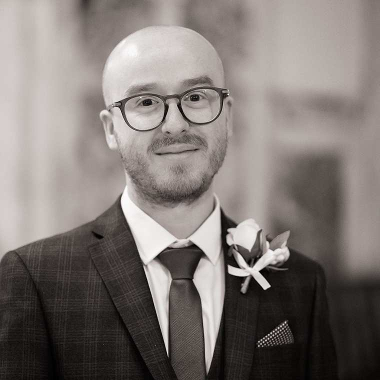 groom head and shoulders portrait in warm black and white