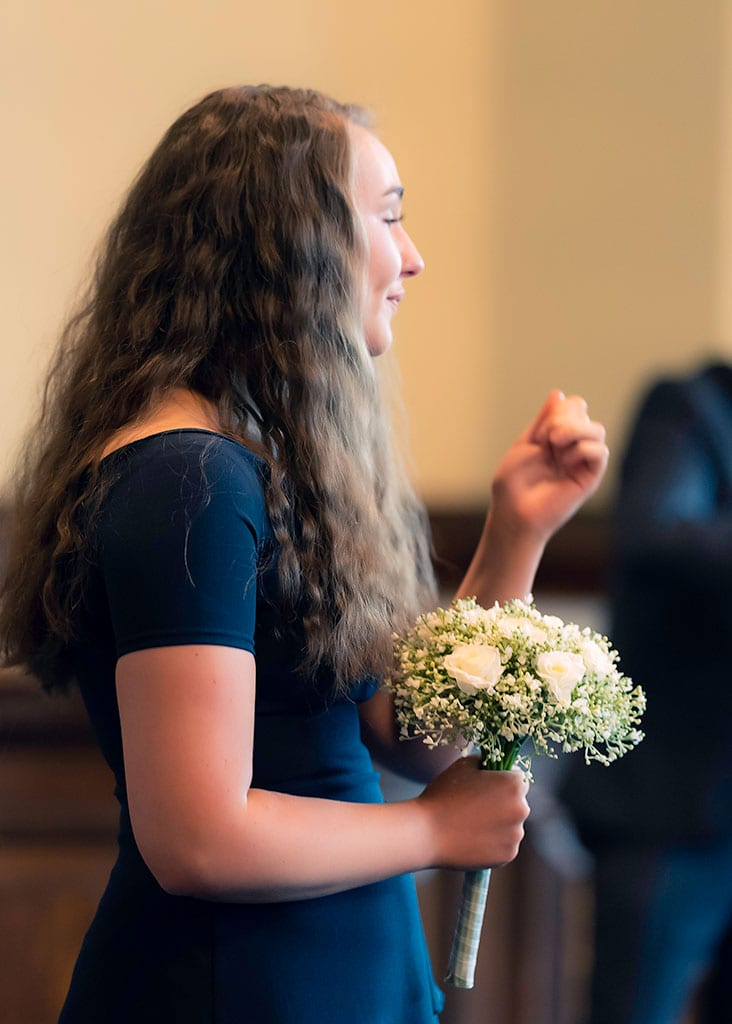 bridesmaid shows emotions during wedding ceremony
