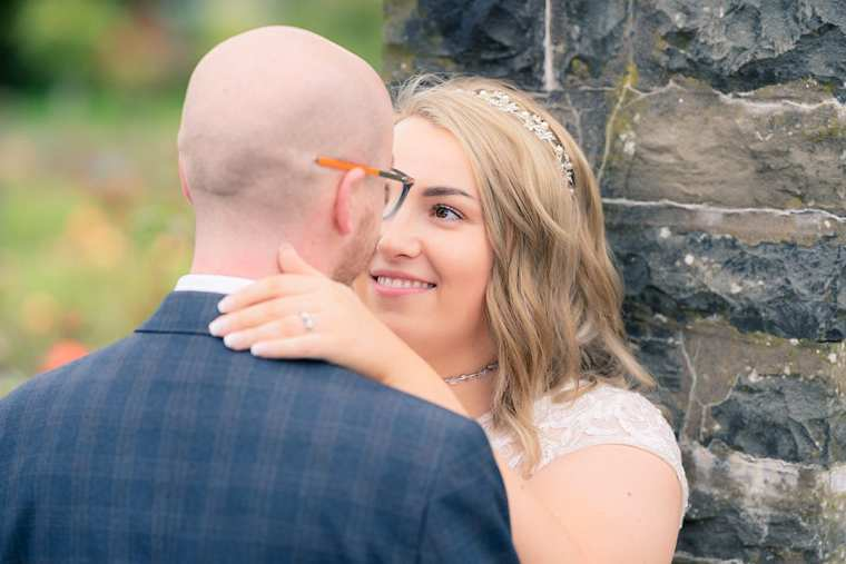 bride and groom portrait at botanic gardens belfast with grooms back to camera