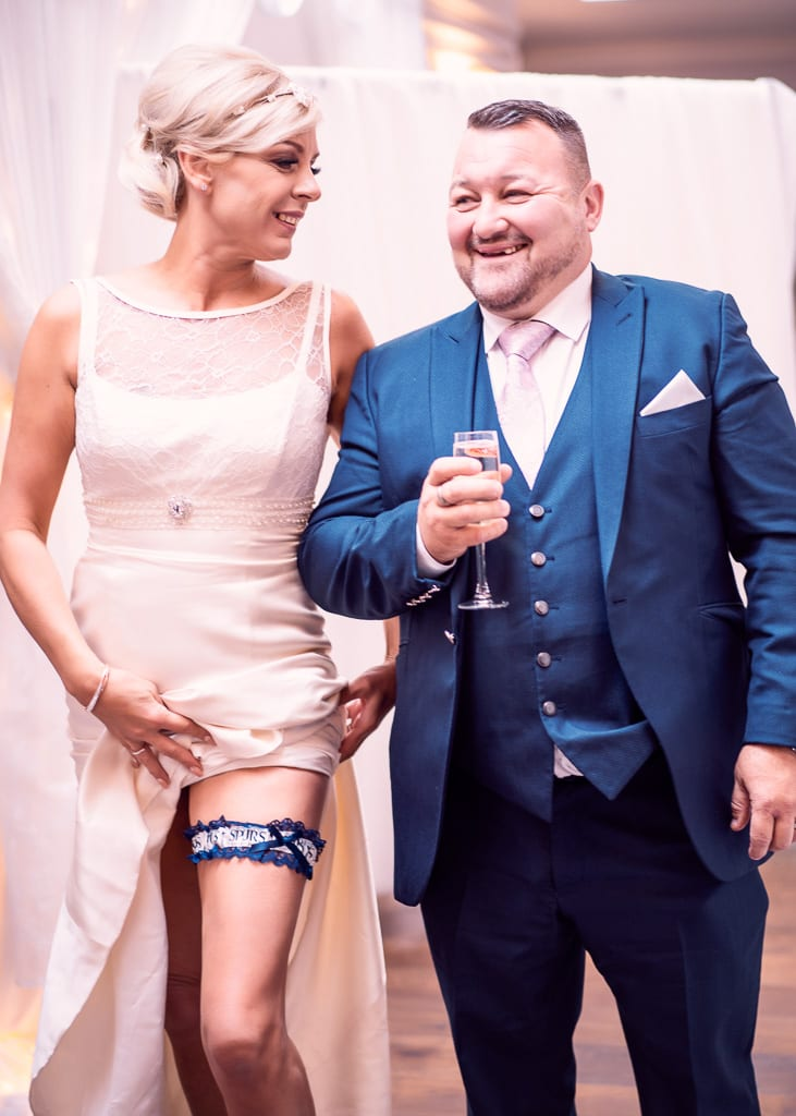 the bride reveals her something blue of wedding traditions