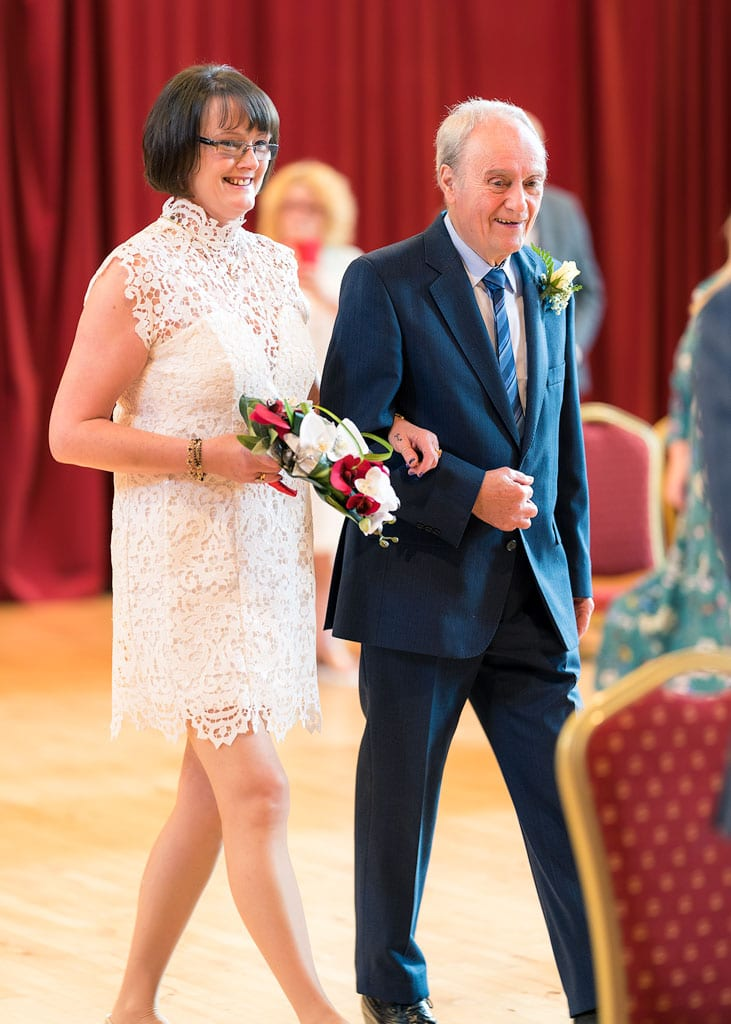 bride arrives accompanied by her dad