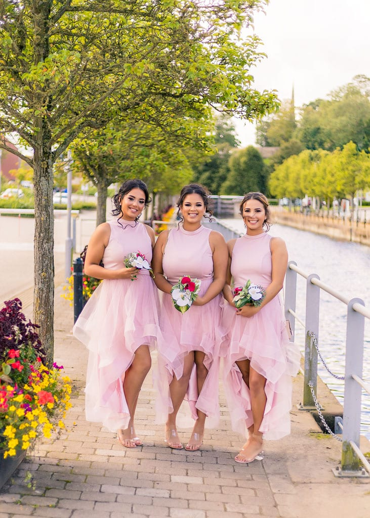 bridesmaids pose by lock side