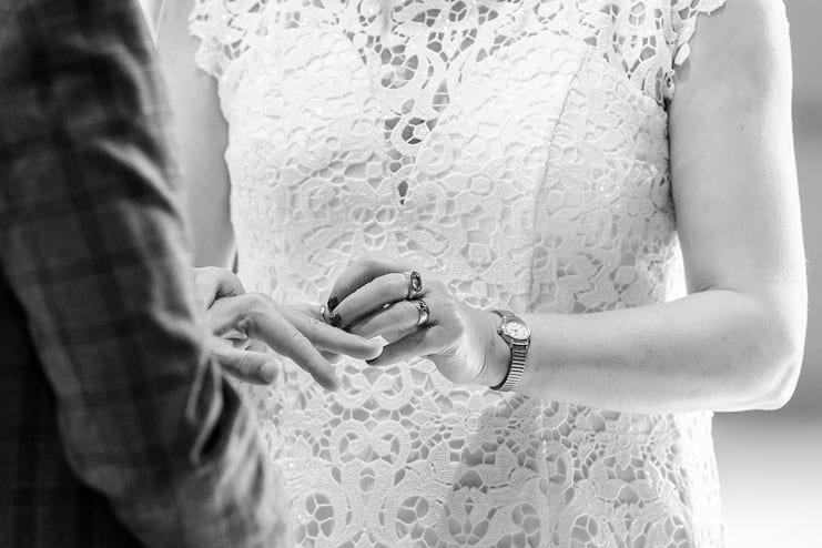 exchange of wedding rings in black and white