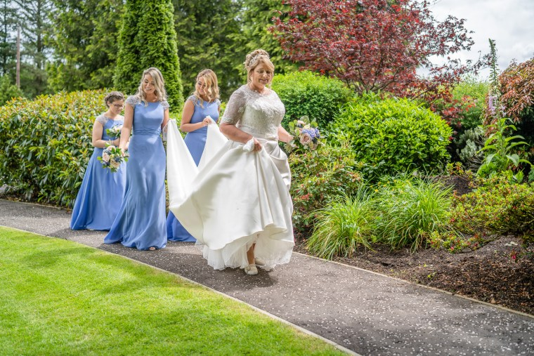 reportage wedding photography bridal party arrive at ceremony