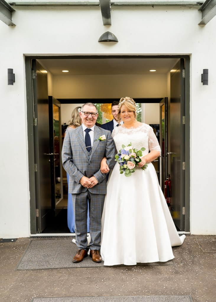 bride and groom at the wedding pavilion doors
