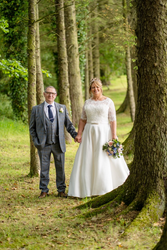 bride and groom portrait in wooded area