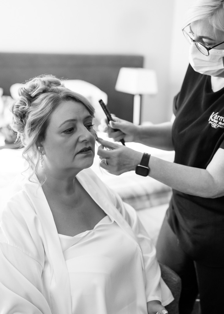 bride getting ready on wedding morning black and white reportage