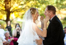 wedding ceremony bride and groom kissing in queenstown