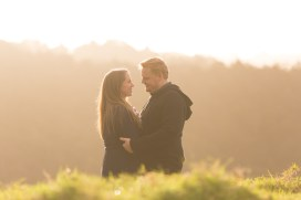 auckland-couple-looking-at-each-other-sunset