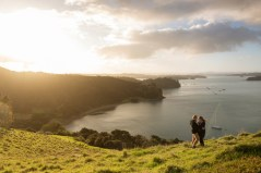 auckland couple standing on a slope during sunset