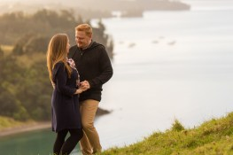 auckland couple embracing in sullivan's bay auckland