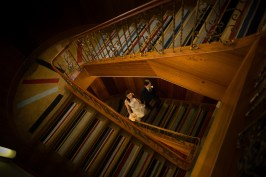 auckland wedding bride and groom walking up the grand staircase