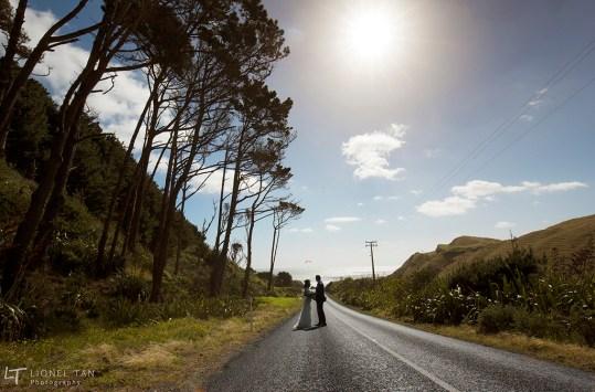 auckland wedding couple portrait on road castaways