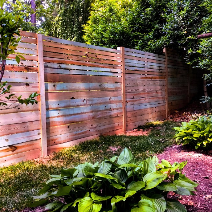 Horizontal board privacy fence