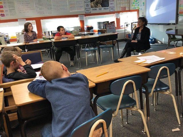 Kid at desk in school head down