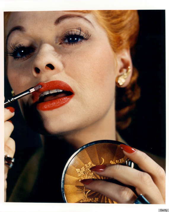 Lucille Ball paints her lips in a scene from the film 'Lured', 1947. (Photo by United Artists/Getty Images)