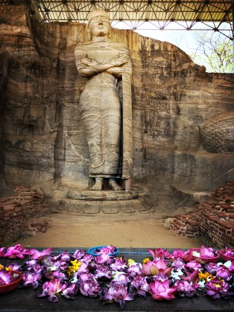 Standing image of Buddha with a sorrowful expression and unusual mudra