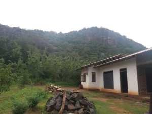 Image of Chaminda's house with the hills in the background