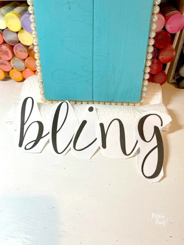 cutout letters, turquoise board