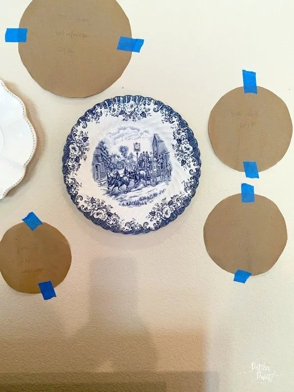 paper templates and plates on wall