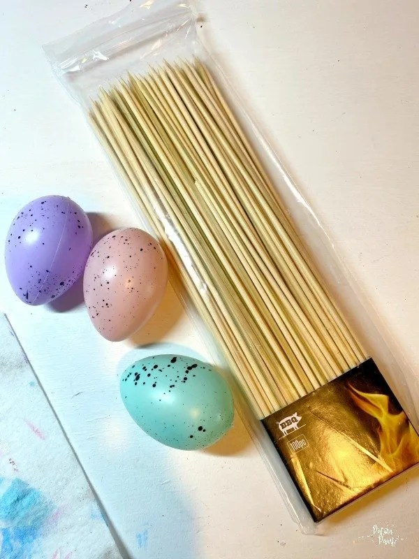 plastic easter eggs, wooden skewers