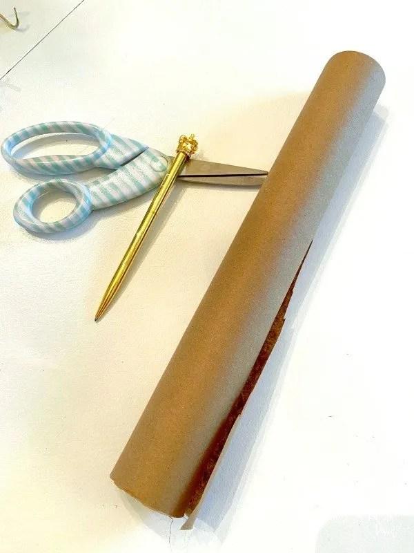scissors, pen, brown paper roll