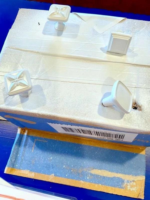 white drawer pulls