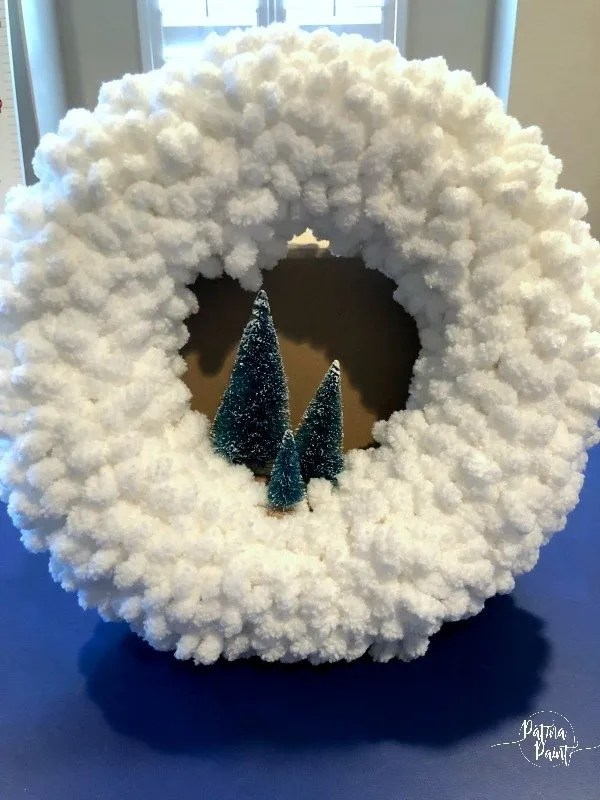 bottle brush trees in a loop yarn wreath
