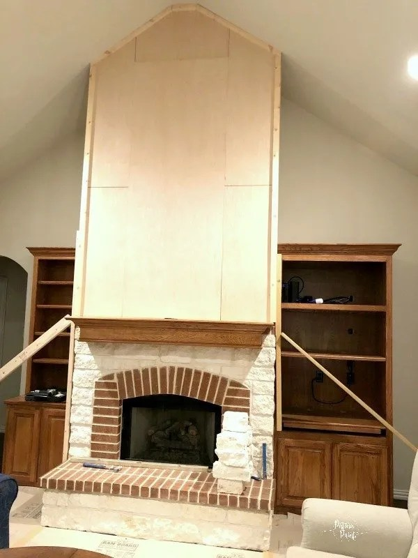 wood wall above the fireplace mantle