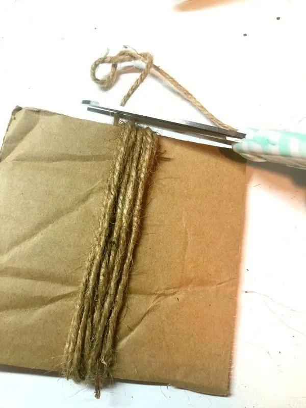 twine wrapped around cardboard