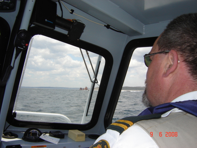 Jeff in the boat at work