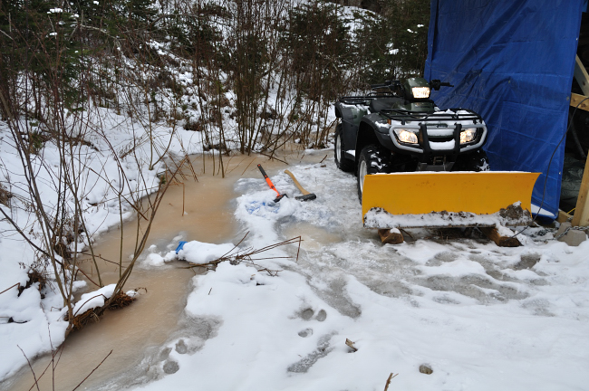 ATV is frozen into the ice!