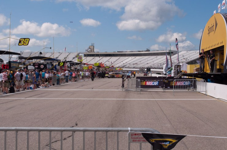 PIt row, looking at the cars lining up.