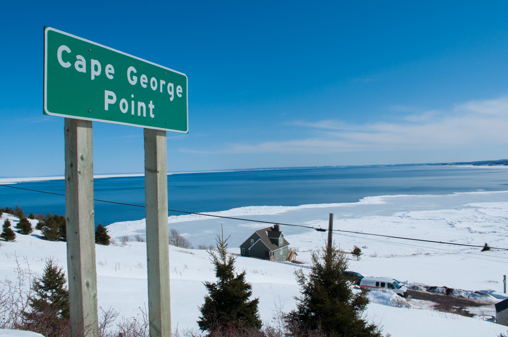 Photo showing the view off Cape George, with the Cape George Point sign in front.